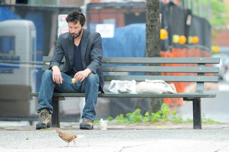 Keanu Reeves has lunch on a park bench in Soho NYC